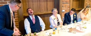 Magician entertains best man at wedding